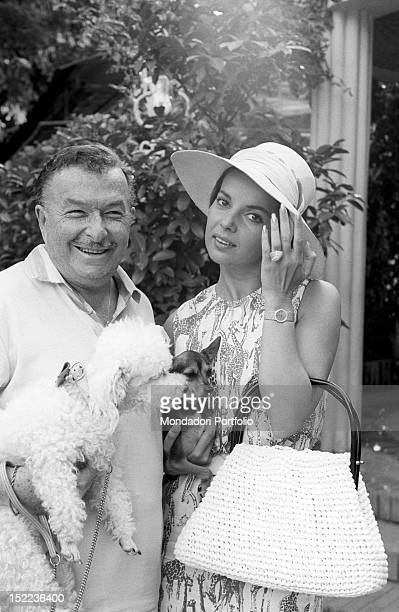 The SpanishAmerican musician and bandleader Xavier Cugat smiling next to his wife the American dancer and actress Abbe Lane Madrid 1963