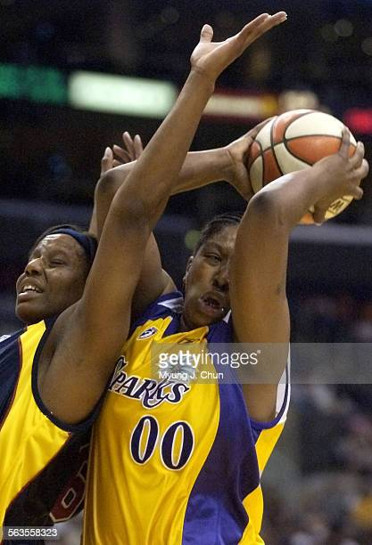 The Sparks' LaTasha Byears beats the Fever's Jackie Moore to a rebound during second half action Sunday at the Staples Center Los Angeles beat...