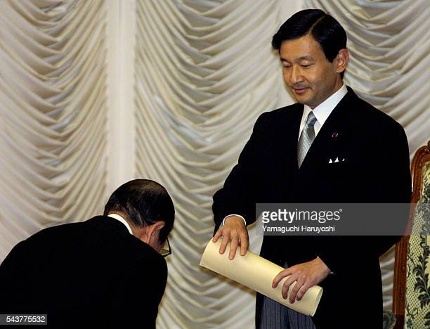 The speaker of the House of Representatives Tamisuke Watanuki bows to Japan's Crown Prince Naruhito during the opening of the parliament session...