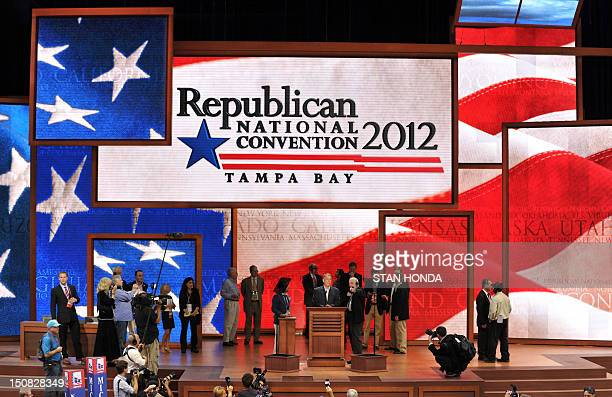 The speaker of the United States House of Representatives John Boehner stands on stage at the Tampa Bay Times Forum in Tampa Florida during final...