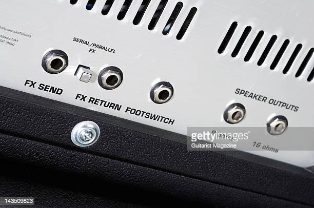 The speaker output and effects send sockets on the rear of a Sound City SC50H electric guitar amplifier head unit during a studio shoot for Guitarist...