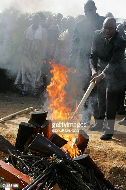 The special envoy of UN secretary-general to Ivory Coast, Abu Mussa , sets on fire weapons 19 May 2007 returned by fighters of the pro-government...