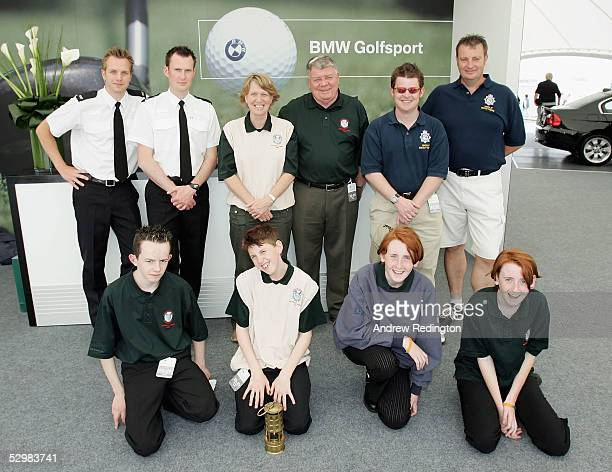 The Special Olympics athletes pose for a photograph in the BMW area in the tented village at The BMW Championship at Wentworth Club on May 26 in...