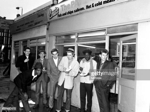 The Specials pop group in chip shop called 'The Parson's Nose' in Bishop Street, Coventry.