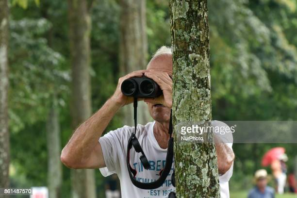 The spectator is using a telescope during the CIMB Classic 2017 day 4 on October 15 2017 at TPC Kuala Lumpur Malaysia