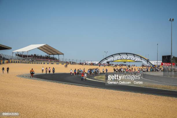The spectators take over the track after the finish of the Le Mans 24 Hours race on June 18 2017 in Le Mans France