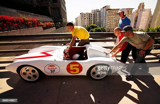 The Speed Racer Team pushes their hand–made soapbox racer back up Grand Avenue after a test run down the hill of Grand Avenue as a few teams...