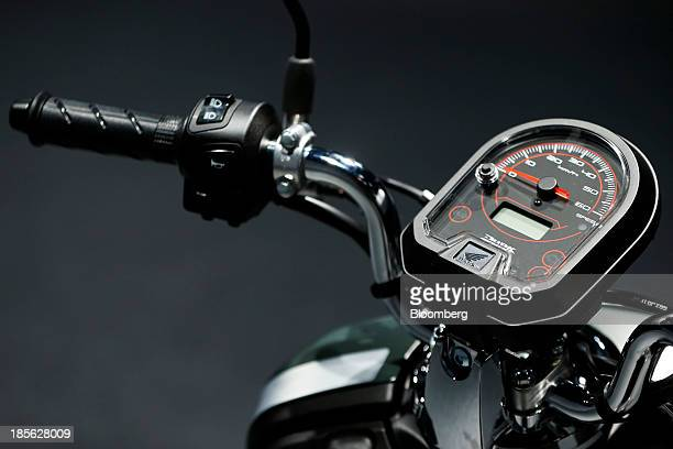The speedometer and handlebars of a Honda Motor Co Dunk scooter are seen during a media event in Tokyo Japan on Wednesday Oct 16 2013 Honda will...