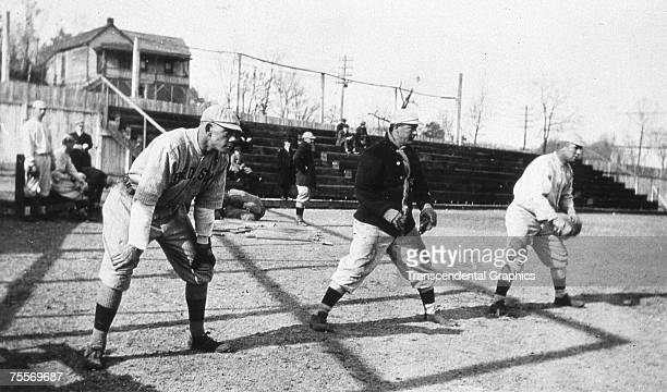 HOT SPRINGS AR MARCH 1912 The speedy outfield for the Boston Red Sox Duffy Lewis Harry Hooper and Tris Speaker pose together at Hot Springs Arkansas...