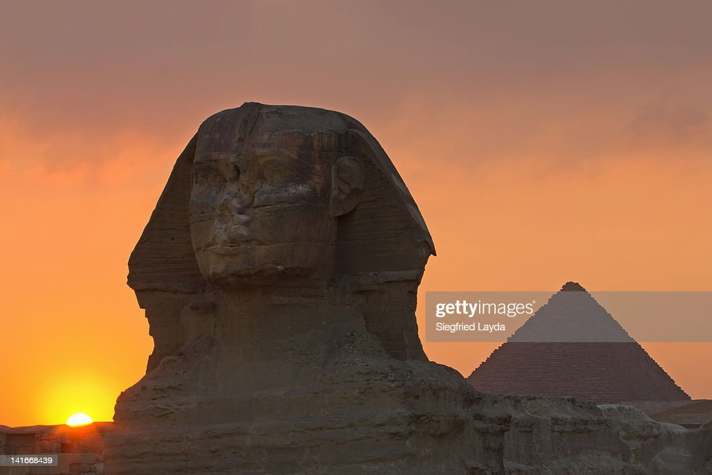 The Sphinx and pyramid at sunset : Stock Photo