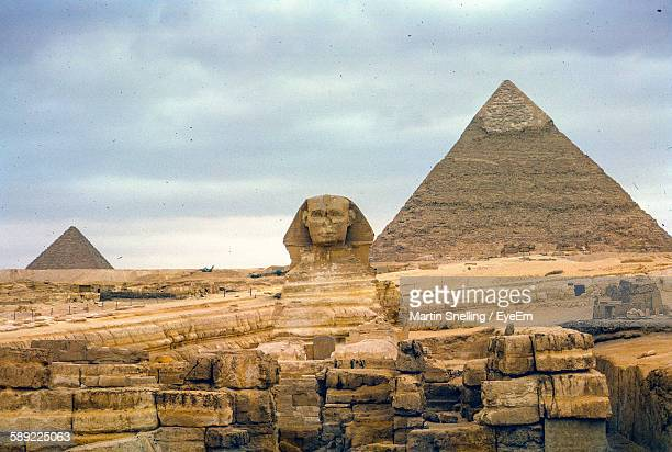 The Sphinx And Pyramid Of Chephren Against Cloudy Sky