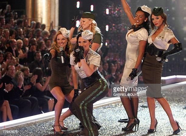 The Spice Girls Emma Burton Melanie Chisholm Geri HalliwellMelanie Brown and Victoria Beckham perform during the Victoria's Secret fashion show at...