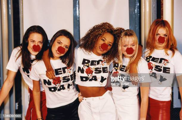 The Spice Girls from left to right, Mel C, Victoria Beckham, Mel B, Emma Bunton and Geri Halliwell all posing with red noses and wearing Red Nose Day...
