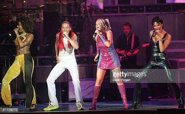 The Spice Girls Melanie Brown Melanie Chisholm Emma Bunton and Victoria Adams performe on stage for the start of there US Tour