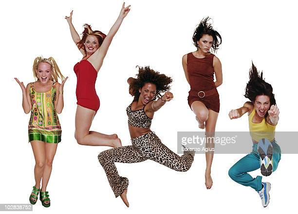 The Spice Girls, pose for a portrait shoot in London, England. Emma Bunton , Geri Halliwell , Mel B , Victoria Beckham and Mel C .
