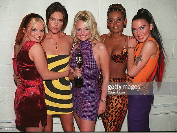The Spice Girls pose with their Brit Award after the annual pop awards ceremony in London 1998
