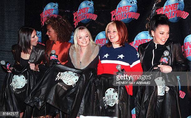 The Spice Girls' Posh Spice Scary Spice Baby Spice Ginger Spice and Sporty Spice pose for photographers with their Planet Hollywood jackets after...