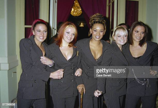 The Spice Girls wear pinstripe to the premiere of their movie 'Spice World' at the Empire Leicester Square 15th December 1997 From left to right...