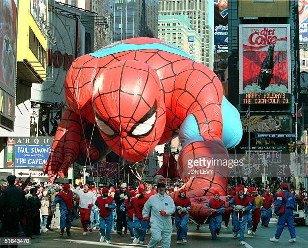 The Spiderman balloon is steered down Broadway into Times Square in New York 27 November as part of the 71st annual Macy's Thanksgiving day parade...
