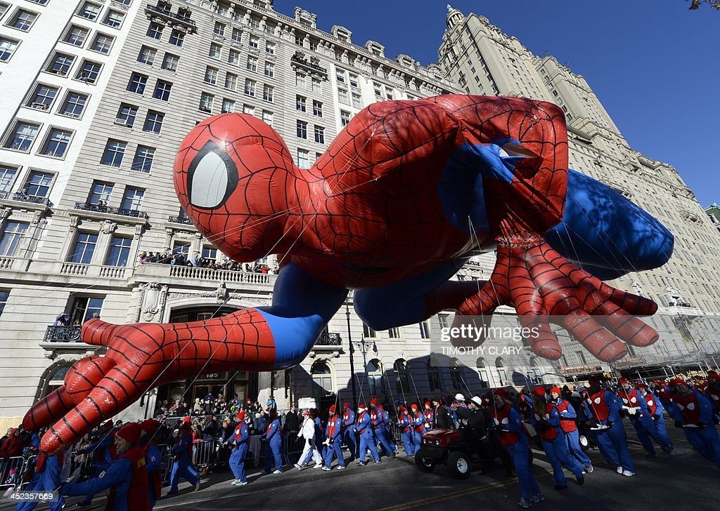 The Spiderman balloon makes its down Central Park West during the 87th Macy's Thanksgiving Day Parade in New York November 28, 2013. There was fear that the iconic balloos could have been grounded if windy conditions had picked up this morning.