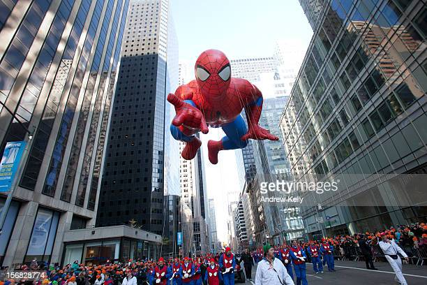 The Spiderman balloon makes its way down Sixth Avenue during the 86th Annual Macy's Thanksgiving Day Parade on November 22 2012 in New York Macy's...