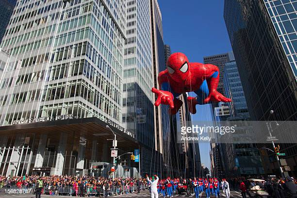 The Spiderman balloon makes its way down Sixth Avenue during the 86th Annual Macy's Thanksgiving Day Parade on November 22 2012 in New York City...