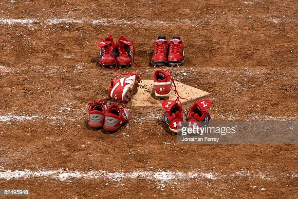 The spikes worn by silver medalists Crystl Bustos Kelly Kretschman Tairia Flowers and Lovieanne Jung of the United States remain at home plate after...