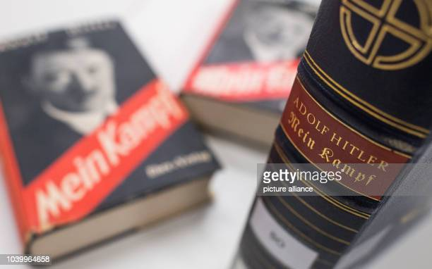 The spine of an edition of Adolf Hitler's book 'Mein Kampf' which was published on Hitler's birthday in 1939 along with other editions from the 1930s...