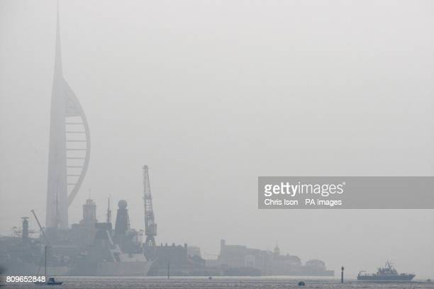 The Spinnaker Tower appears in the mist over Portsmouth Harbour
