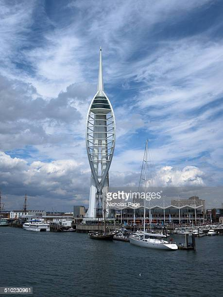 The Spinnaker Tower in Portsmouth Harbour as seen from the sea In the foreground is the sea The tower is set against a beautiful blue sky with...