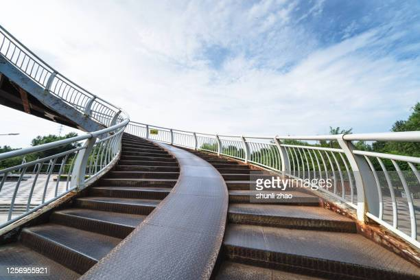 the spiral staircase of the viaduct - elevated walkway stock pictures, royalty-free photos & images