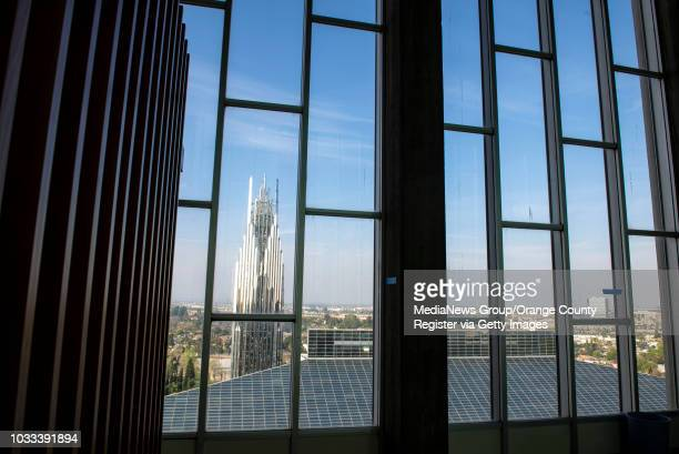 The spire, left, and the top of the Crystal Cathedral can been seen through the windows of the Chapel in the Sky on the top floor of the 13-story...