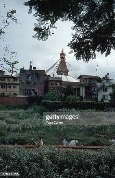 The spire of Bodhnath stupa rises above the surrounding buildings on the outskirts of Nepal's capital Kathmandu. The country's largest stupa,...