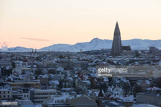 The spire of Hallgrimskirkja church right stand above residential and commercial property on the city skyline in Reykjavik Iceland on Thursday Jan 14...