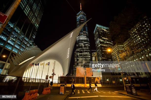 The Spire of One World Trade Center stands lit in orange to support a bid for Amazoncom Inc's second headquarters in New York US on Wednesday Oct 18...