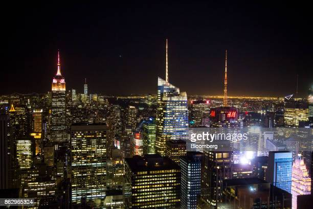 The spires of the Empire State Building from left One World Trade Center 1 Bryant Park and 4 Times Square stand lit in orange to support a bid for...