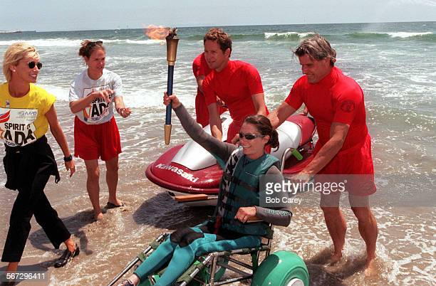 The Spirit of ADA Torch Relay kicked off as Sarah Wills held the torch as she rode a jet ski to the beach by the Venice Pier. The relay celebrates...
