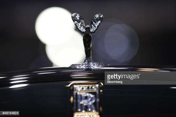 The Spirit of Ecstasy bonnet ornament sits on a RollsRoyce automobile produced by Bayerische Motoren Werke AG as it stands on display on the first...