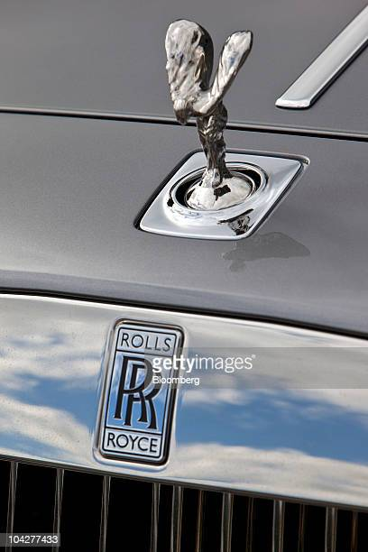 "The Spirit of Ecstasy or ""Flying Lady"" mascot sits on a Rolls Royce automobile at the Rolls-Royce Motor Cars Ltd. Plant in Goodwood, U.K., on..."