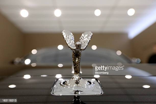 "The Spirit of Ecstasy or ""Flying Lady"" mascot sits on a Rolls-Royce Wraith automobile, produced by Rolls-Royce Motor Cars Ltd., ahead of the opening..."