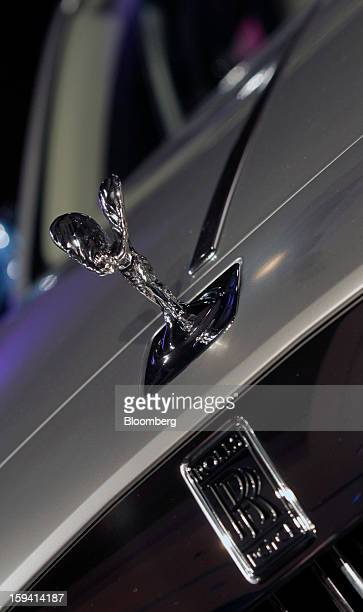 The Spirit of Ecstasy or 'Flying Lady' mascot sits on the hood of a RollsRoyce Phantom luxury automobile produced by RollsRoyce Motor Cars Ltd at The...