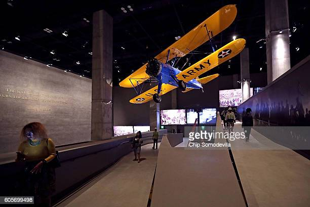 The Spirit of Tuskegee a PT13 Stearman biplane flown by Tuskegee Airmen training to fight in WWII hangs from the ceiling above the concourse...
