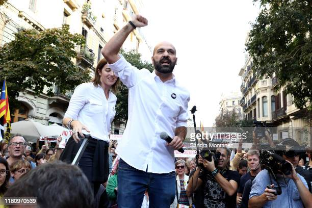 The spokesman of Omnium, Marcel Mauri, is seen talking while demostrators take part in a protest following the sentencing of nine Catalan separatist...
