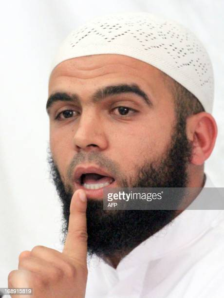 The spokesman of Tunisia's hardline Salafist group Ansar alSharia Seifeddine Rais speaks with journalists during a press conference on May 16 2013 in...