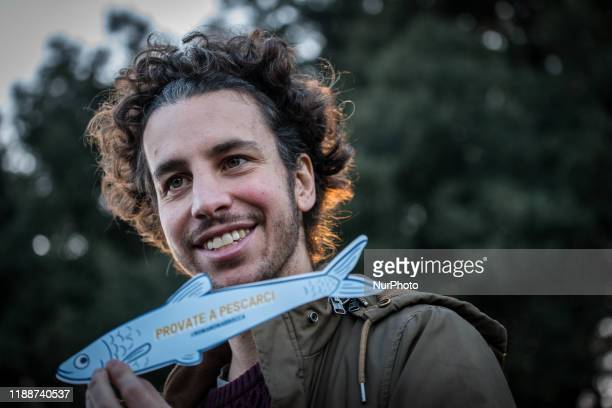 "The spokesperson of the ""Sardines"" an Italian grass-roots movement against right-wing populism, Mattia Santori, talks during a gathering in..."