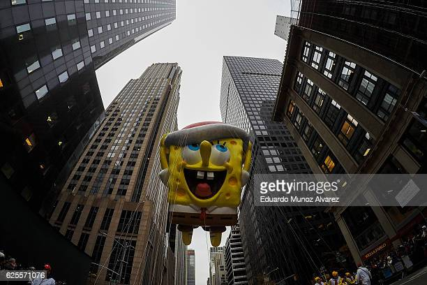 The Spongebob Sqaure Pants balloon floats down 6th Av during the 90th Macy's Annual Thanksgiving Day Parade on November 24 2016 in New York City...