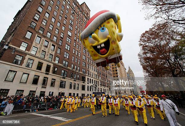 The SpongeBob SquarePants balloon floats down Central Park West in the Macy's Annual Thanksgiving Day Parade on November 24 2016 in New York City