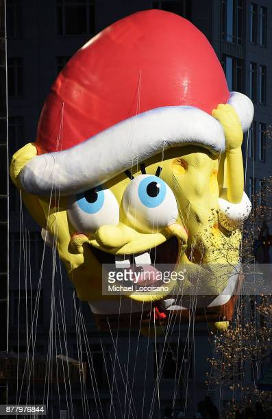 The SpongeBob SquarePants balloon floats down Central Park West during the 91st Annual Macy's Thanksgiving Day Parade on November 22 2017 in New York...