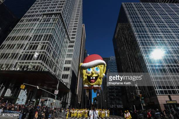 The SpongeBob SquarePants balloon floats on 6th Ave during the annual Macy's Thanksgiving Day parade on November 23 2017 in New York City The Macy's...