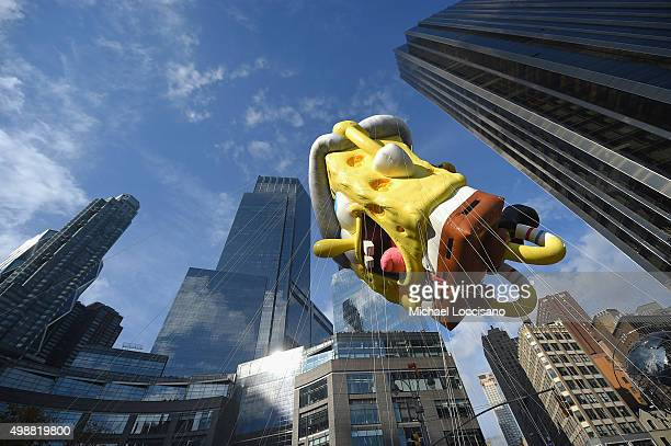 The SpongeBob SquarePants balloon floats through the parade route during the 89th Annual Macy's Thanksgiving Day Parade on November 26 2015 in New...